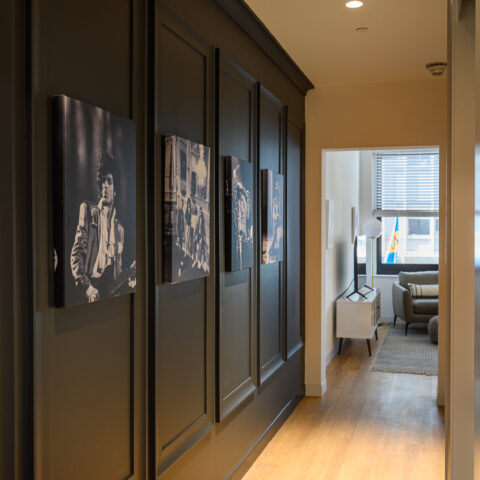 black hallway with historic photos 101 dupont place 1 bedroom apartment wilmington delaware