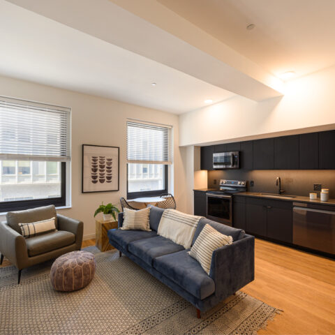 black kitchen and living room in 101 dupont place 1 bedroom apartment wilmington delaware
