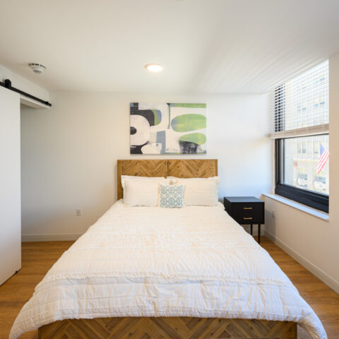 bedroom with barn door closet in 101 dupont place apartment wilmington delaware