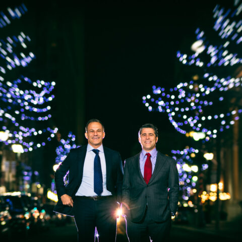 Buccini Brothers stand on Market Street between lighted trees